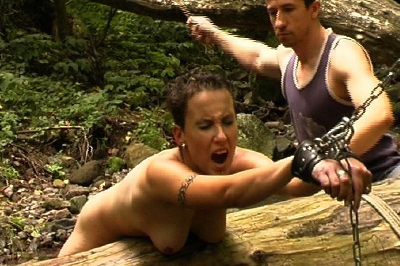 Rush of the water sting of the cane  strung over a downed tree and tied to branches this whore gets a lovely anal caning that leaves her wet and moaning. Strung over a downed tree and tied to branches, this whore gets a pleasant booty caning that leaves her wet and moaning